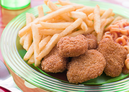 A very typical Western kid's meal includes chicken nuggets, potatoes, and canned spaghetti products.