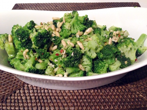 Broccoli sauteed with garlic, red pepper flakes, and pine nuts.