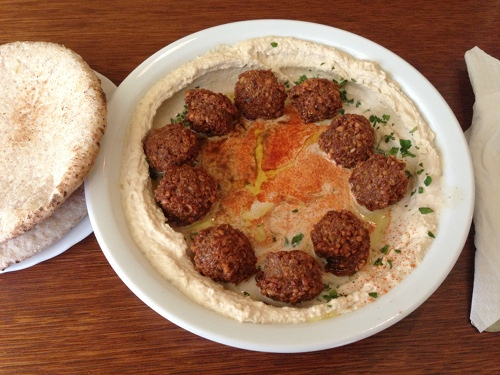 Hummus Bar in Budapest serves this delicious and huge falafel plate with whole wheat pita.
