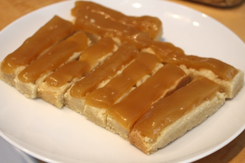 Layering caramel onto the shortbread cookies