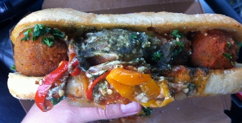 Native Foods meatball sub with sauteed peppers and pesto.