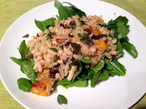 Quinoa salad recipe with roasted butternut squash, arugula, mint, and raisins.