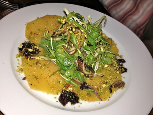 Vedge's roasted rutabage salad with arugula and shiitake mushrooms, charred onions, and pistachios.