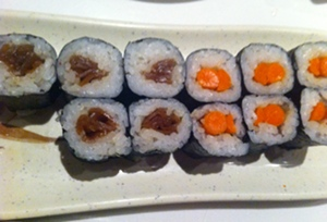 Sansei Maui pickled burdock sushi roll and kampyo maki sweet squash roll.