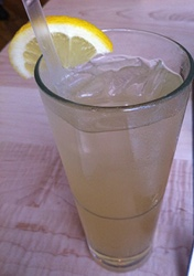 A lemon ginger shrub, or apple cider vinegar drink flavored with lemon and ginger.