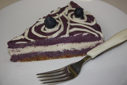 Slice of raw blueberry cheesecake, raw and vegan.