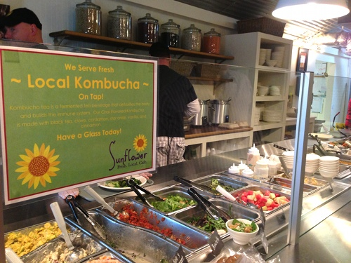 Sunflower Cafe serves their food in a salad bar line.