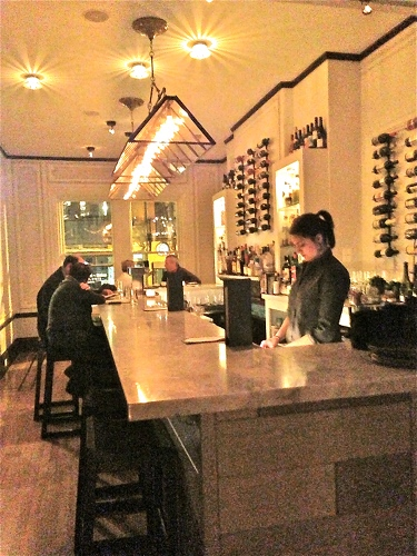 The bar inside Vedge is chic and inviting.