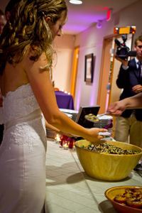 Being served the black bean salad from our vegan wedding menu.