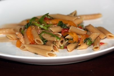 Vegan Pasta la Caprese with whole wheat penne, fresh summer tomatoes, a hot pepper, and basil, garlic, and olive oil.