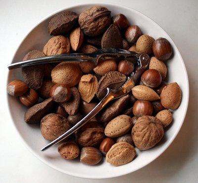 A variety of nuts still in their shells.