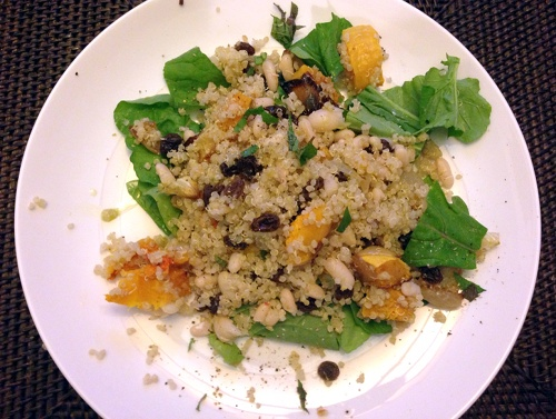 Vegan quinoa salad recipe with white beans, roasted butternut squash and onions, arugula, raisins, and walnuts.