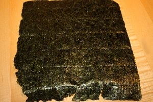 In addition to using it for sushi rolls, you can crumble a sheet of nori seaweed over any meal to add a punch of flavor and vitamins and minerals.