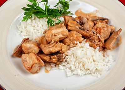 A very typical Western pattern meal with a bunch of cooked chicken and white rice.