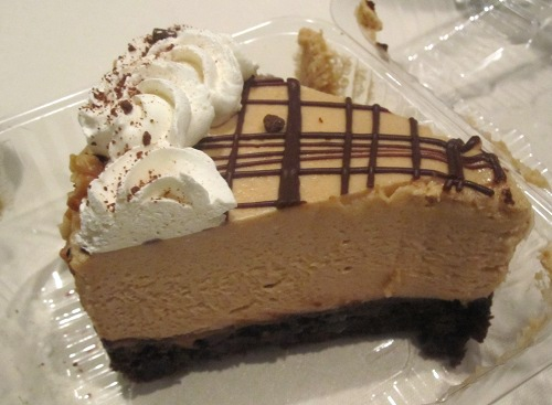 Chocolate peanut butter mousse cake with vegan whipped cream.